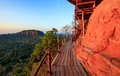 Cliff side wooden bridge at wat phu tok bueng kan thailand temple province Royalty Free Stock Image