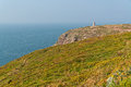 Cliffs with flowers and old tower at the cape of frehel brittany france Royalty Free Stock Images