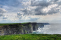 Cliffs of moher dramatic colors with clouds and sea clare county ireland Stock Images