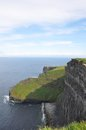 Cliffs of moher green slopes and the famous in western ireland on a sunny summer day Royalty Free Stock Images