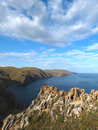 Cliffs near aya bay at lake baikal fog next to these there is a group of caves Royalty Free Stock Photo
