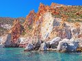 The cliffs and rock formations of Polyaigos, an island of the Greek Cyclades Royalty Free Stock Photo