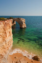 Cliffs and transparent water in algarve portugal wild beach summer Royalty Free Stock Photography