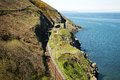 Cliffwalking between bray and greystone ireland irish railway passing by the coast Stock Image