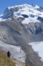 Climber in the alps a approaches monte rosa with glaciers all around southern swiss above zermatt on a sunny summer day Stock Photos