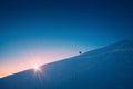 A climber climbs up a snowy slope Royalty Free Stock Photo
