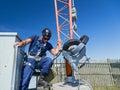 Climber gets ready to climb tower braces himself begin climbing an antenna Stock Photo