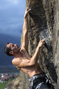 Climber man climbing cliff italian alps Stock Photography