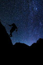 Climber on the rock milky way background Royalty Free Stock Images