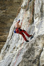 Climber the rock during rock conquest young climbing in the dolomits Stock Images
