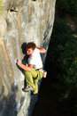 Climber the rock during rock conquest young climbing in the dolomits Royalty Free Stock Image
