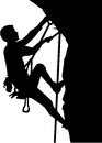 Climber silhouette in ropes an a rock Royalty Free Stock Photo