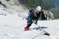 Climber on snow summit, rocky mountain peaks and glacier Royalty Free Stock Photo