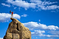 Climber on the summit. Royalty Free Stock Images