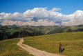 Climber walking on mountain path in the dolomites italy Stock Image