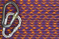 Climbing equipment background two carabiners on a rope showing hiking safety great for extreme sports shops Royalty Free Stock Photography