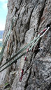 Climbing equipment close up building a belay stance in the swiss alps Stock Images