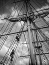 Climbing the masts men getting ready to set sail Stock Image
