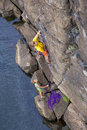 Climbing partners make ascent on to the rock wall Royalty Free Stock Photo