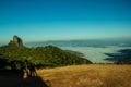 Climbing rock in brazil pedra do baú trank and two human shadows Stock Photos