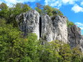 "Climbing rock landscape with climbers train on a in the nature reserve of danube gorge's ""weltenburger enge"" bavaria germany Royalty Free Stock Image"