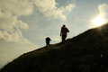 Climbing silhouette of two men trekking on the mountain Stock Photography