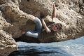 Climbing smiling young person under the water in a sunny day Royalty Free Stock Photo