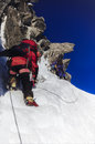 Climbing team on snow and rock two man mountain arete du cosmique in chamonix france Royalty Free Stock Photos