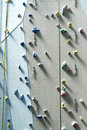 Climbing wall background with ropes and holds Royalty Free Stock Images