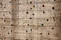 Climbing wall background surface of rock with holds Stock Photography