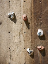 Climbing wall closeup of wooden with five holds Royalty Free Stock Image