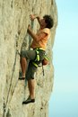 Climbing young white man a steep wall in mountain rock extreme sport summer season Royalty Free Stock Photo