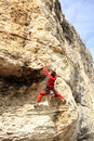 Climbing young white man a steep wall in mountain rock extreme sport summer season Royalty Free Stock Photography