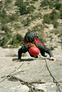 Climbing young white man a steep wall in mountain rock extreme sport summer season Stock Photography