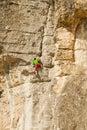 Climbing young white man a steep wall in mountain rock extreme sport summer season Royalty Free Stock Photos