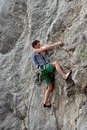 Climbing young white man a steep wall in mountain rock extreme sport summer season Royalty Free Stock Image