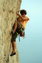 Climbing young white man a steep wall in mountain rock extreme sport summer season Royalty Free Stock Images