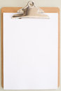 Clipboard and empty white page Stock Photography
