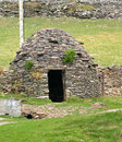 A clochan medieval beehive stone house called on dingle peninsula Royalty Free Stock Image