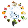 Clock arranged from healthy fruits splash by water isolated on w