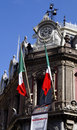Clock and bells at the top of estanquillo museum in mexico a old building capital city with two mexican flags weaving below madero Royalty Free Stock Image