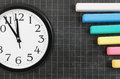 Clock and blank school board with chalk Royalty Free Stock Photos