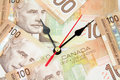 Clock and canadian dollars Royalty Free Stock Photo