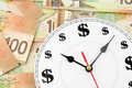 Clock and canadian dollars Stock Photo