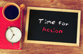 Clock, coffee cup and blackboard with the phrase time for change Royalty Free Stock Photo