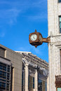 Clock on the corner of historic building in washington dc a street against blue sky with thin clouds Stock Photos