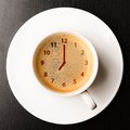 Clock cup of fresh espresso with clock sign view from above Royalty Free Stock Photo