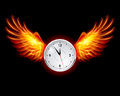 Clock with fire wings Royalty Free Stock Image