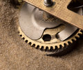 Clock gears in sand mechanical endurance Royalty Free Stock Photo