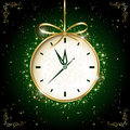 Clock on green background with bow illustration Stock Image